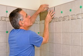 handyman re-tiling a shower in Denver, Colorado