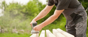 handyman sanding wood in Fort Collins, CO
