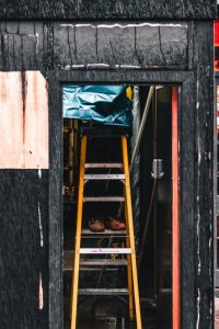 handyman practicing ladder safety in Colorado Springs, CO